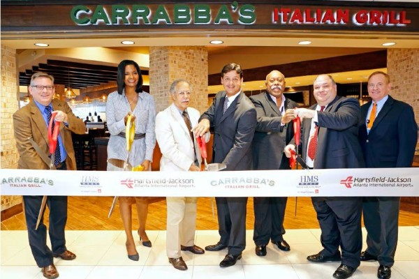 Cutting the ribbon from left to right: Kent Vanden Oever, Vice President, Business Development, HMSHost; Vivica Brown, Assistant GM for Commercial Development, Hartsfield-Jackson Atlanta International Airport; C.T. Martin, Councilmember, District 10; Peter Amaro, CEO, Master Concessionair-ATL LLC; Dwayne Heard, Partner, Master Concessionair-ATL LLC; Tim Slaney, Vice President, Operations, HMSHost; Kyle Mastin, Interim Concessions Director, Hartsfield-Jackson Atlanta International Airport