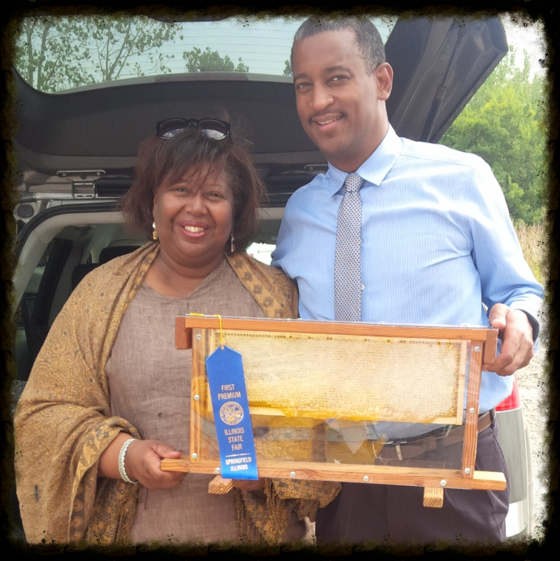 Brenda Palms Barber, CEO of Sweet Beginnings, with David Robbins, CDA Projects Administrator - Environment & Sustainability, and the award-winning O'Hare honeycomb.