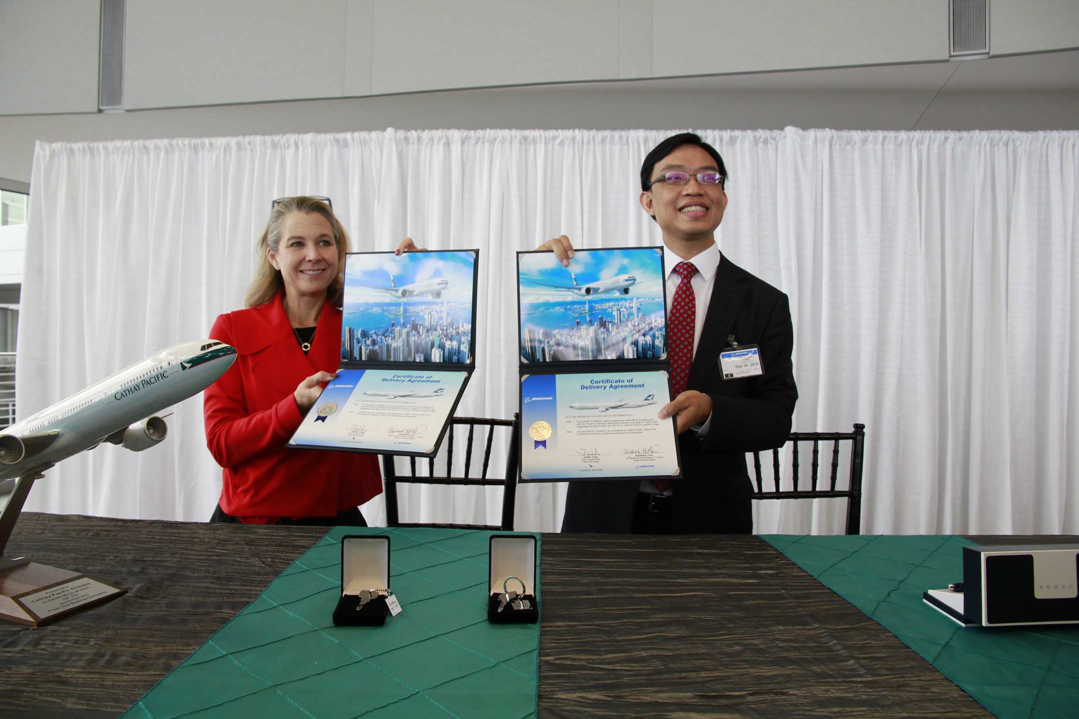 Ms Elizabeth H Lund, Vice President and General Manager, 777 Program and Everett Site, Boeing Commercial Airplanes (left) and Mr James Tong, Director Corporate Affairs, Cathay Pacific Airways at the signing ceremony for Cathay Pacific's 70th 777 aircraft. Cathay Pacific took delivery of the 777-300ER aircraft on 26 September 2015 and is Asia's largest operator of the 777 fleet.