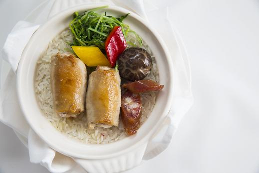 Steamed rice with Berkshire pork and goose liver roulade with Chinese preserved sausages in hot pot casserole for First Class passengers