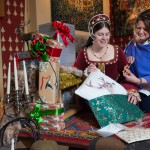 Cherene Robertson, owner of Stirling business Wrapistry by Cherene, shows Mary of Guise (Clara Koenig) some creative Christmas present wrapping ideas in the opulent surroundings of the Queenís Inner Hall at Stirling Castle ahead of the castle's Christmas Shopping Fayre (1st December) and late night opening at the 'Clan and Christmas' shop (9th, 16th and 23rd December). A full list of Christmas events at Stirling Castle can be found at http://bestdaysever.co.uk/christmasevents