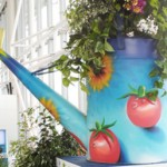 Bristol Airport hosts Cleeve Nursery's giant-sized watering can as part of the Chelsea Fringe Festival