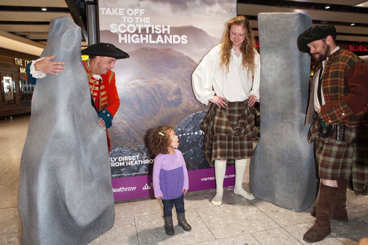 Evelyn Lamous from Chicago meets members of the Clanranald Trust at Heathrow Airport