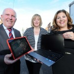 Roberta Richmond from East Belfast Community Counselling shows Human Resources and Corporate Responsibility Director at Belfast City Airport Michelle Hatfield and east Belfast councillor Jim Rodgers the benefit of being mobile.