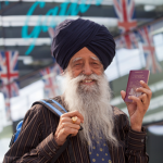 Fauja Singh, the winner of Gatwick Airport's UK's oldest traveller competition, arrives at Gatwick's North Terminal