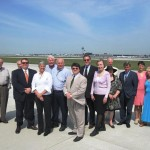 Union League Club members stop for a quick photo during tour of airfield at O'Hare International Airport on August 23, 2012