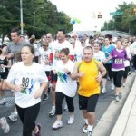"President and CEO Arne Sorenson (left in gray shirt) joined more than 300 associates for a 5K/1K Run & Walk to celebrate the two-year anniversary of the company's ""TakeCare"" Wellness program."