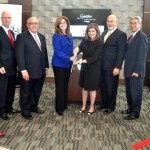 (Left to right) Geoff Heck, Regional VP, Signature; Mark Costa, Chicago Area Dir., Signature; CDA Commissioner Andolino; Maria Saster, COO, Signature; John Manning, Kraus Manning Construction and Hank Mook, Gen. Mgr., Signature O'Hare.