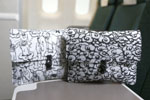 """Cathay Pacific's newly launched amenity kit for Premium Economy Class features two exclusive design - """"Joy"""" (left) and """"Fortune"""" (right), by home-grown Hong Kong brand G.O.D."""
