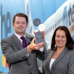 General Manager of Market Development at Flybe Andrea Hayes and Flybe Regional Sales Manager Ken Harrower pictured holding the 'Airline of the Year for the UK & Ireland' Award
