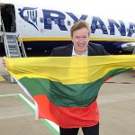 Leeds Bradford Airport's Commercial Director, Tony Hallwood, flies the Lithuanian flag to celebrate the launch of the new route to Vilnius