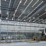 Scaffolding goes up around an Air New Zealand Boeing 777-300ER ahead of installation of the 830 square metre graphic image.