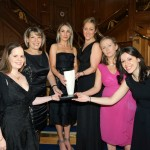 The Commercial and Marketing team pictured holding the Award