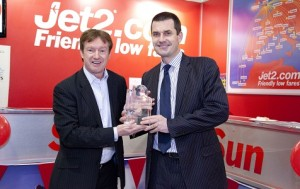 Leeds Bradford Airport's Commercial Director, Tony Hallwood, presents Steve Heapy, Jet2.com's Chief Executive, with a glass globe plaque to mark the airline's tenth anniversary