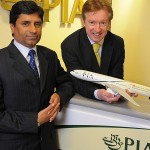 PIA's Muhammad Shafique (L) and Leeds Bradford Airport's Tony Hallwood (R) welcome the introduction of Pakistan International Airlines' Boeing 777 operations from LBA to Islamabad.
