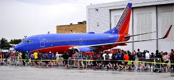 More than 700 runners, walkers and aviation enthusiasts participated in Chicago Midway International Airport's first-ever run on the airfield