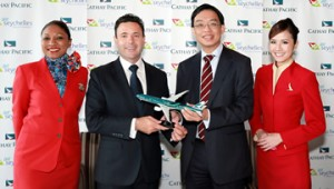 """Cathay Pacific General Manager Revenue Management Mr James Tong presents a Cathay Pacific aircraft model in a special """"Asia's world city"""" livery to Air Seychelles Chief Executive Officer Mr Cramer Ball following the signing of the code-share agreement between the two airlines."""