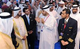 His Highness Sheikh Mohammed bin Rashid Al Maktoum, UAE Vice President, Prime Minister and Ruler of Dubai views the scale model of Emirates Flight Academy at the Dubai Air Show. Explaining the initiative, is Adel Al Redha, Emirates Executive Vice President & Chief Operations Officer. With him is Capt Abdulla Al Hammadi, Emirates' National Cadet Pilot Manager.
