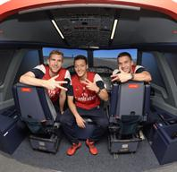 Lukas Podolski, Mesut Özil and Per Mertesacker inside the state of the art A380 flight simulator, at the Emirates Aviation Experience in London.