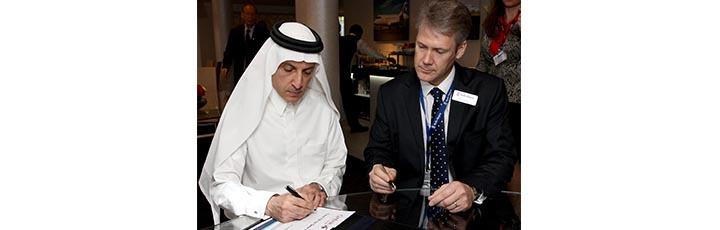 On Day Two of the Dubai Air Show, Qatar Airways Chief Executive Officer, Akbar Al Baker (left) and Rolls Royce President - Aerospace, Tony Wood signing an agreement for Trent 700 engines to power five Airbus A330 freighter aircraft