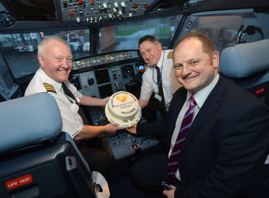 Captain George Carnell and First Officer Andy Queen celebrate the arrival of the new Thomas Cook Airbus A321 aircraft with Uel Hoey, business development director at Belfast International Airport