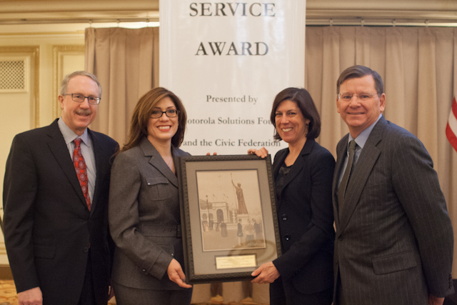 "Pictured left to right: Mark Davis, Chairman, Civic Federation; Rosemarie S. Andolino, Commissioner, CDA; Michelle Warner, Corporate VP, Deputy General Counsel and Secretary, Motorola Solutions; and Laurence Msall, President, Civic Federation with the Motorola/Civic Federation ""Excellence in Public Service"" Award at the Palmer House Hilton in Chicago on December 17, 2013."
