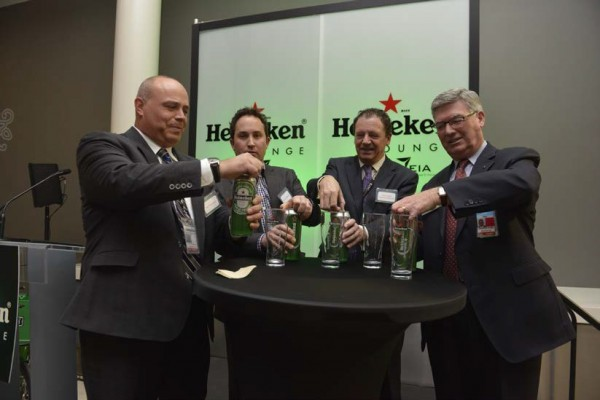 Neil Thompson, HMSHost, Vice President of Canadian Operations (left), Warren Matheos, Regional Director West, Heineken Canada (second from left), Dutch Consul General Johannes Vervloed (second from right) and EIA President and CEO Reg Milley (right) open their giant 710ml cans of Heineken to celebrate the 1st anniversary of the Heineken Lounge at EIA.
