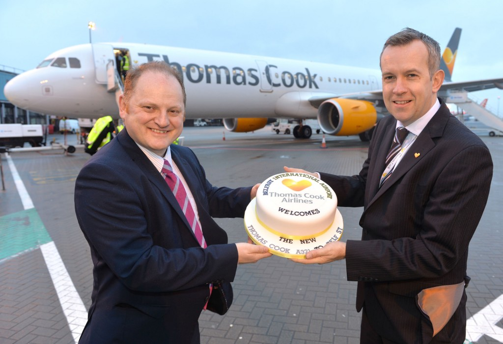 Thomas Cook station manager Jason Whiteside is pictured with Uel Hoey business development director at Belfast International Airport as they welcome the new Thomas Cook Airbus A321 to Belfast International Airport