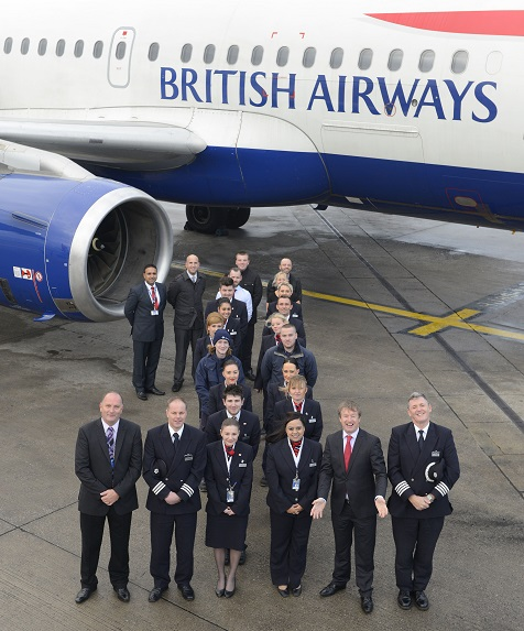 The Leeds Bradford team celebrating the first anniversary of British Airways' London Heathrow route. Across the front of the figure one (left-right) are: Simon Lea, British Airways airport manager, senior first officer Edward Chapman, customer service agents Bryony Glover and Saima Akhtar, Tony Hallwood, Leeds Bradford airport's aviation development and marketing director and Captain Christopher Shaw