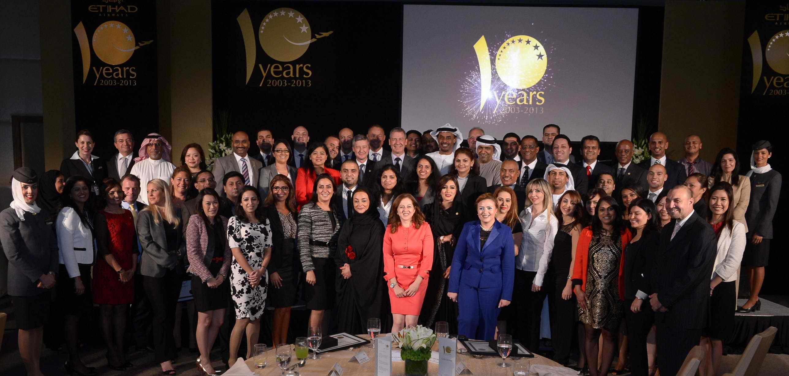Etihad Airways longest serving staff members celebrate their ten-year achievements with airline management executives.