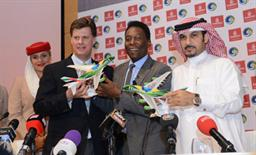 Sheikh Majid Al Mualla, Emirates' Divisional Senior Vice President, Commercial Operations, Centre with New York Cosmos Chairman Seamus O'Brien and Pelé after announcing a two year extension to the airline's sponsorship of the club.