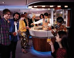 The Emirates A380 Onboard Lounge offers passengers a chance to socialise and network over specially selected beverages and canapés.