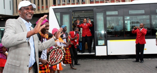 KQ Group CEO, Dr. Titus Naikuni joins traditional dancers in welcoming guests to the new infield shuttle bus