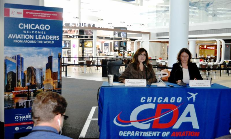 Rosemarie S. Andolino, Commissioner, Chicago Department of Aviation (left) and Katie Bland, Director, Routes and UBM Live (right) speak to reporters at a news conference in Terminal 5 at O'Hare International Airport today.