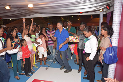 "Guyana Expo Fans having a Blast at the ""Putt and win and Fly ""booth activity."