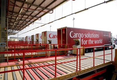 Offloading cargo bound for the SkyCargo warehouse at DWC