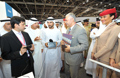 HH Sheikh Hamdan bin Mohammed bin Rashid Al Maktoum, Crown Prince of Dubai visits Emirates' stand at GITEX Technology Week 2014 at Dubai International Convention & Exhibition Centre. Sheikh Hamdan is seen with Oculus, one of the featured Emirates' proprietary technology applications. With Sheikh Hamdan (on his right) is HE Helal Saeed Almarri, director general, Dubai Department of Tourism and Commerce Marketing