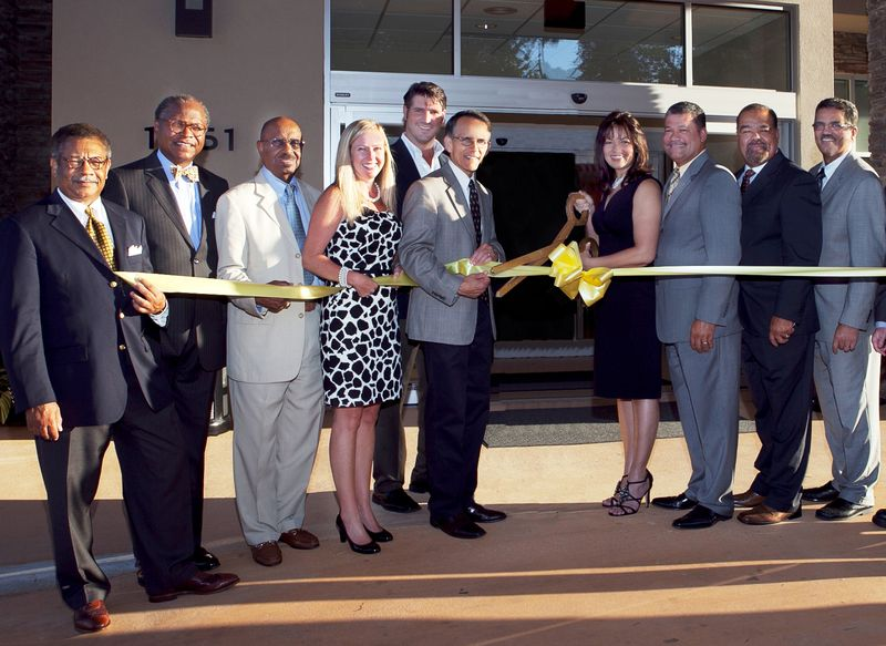 Ribbon cutting (2011) for the grand opening of the SpringHill Suites by Marriott Lake Charles.  From left to right:  Jack Ezzell,  Alvin Schexnider, William Grace, Tamra Markham (hotel management group), Lake Charles City Councilman John Falgout, Lake  Charles Mayor Randy Roach, Evette Gradney, John Biagas, Mark Biagas, Randy Biagas.