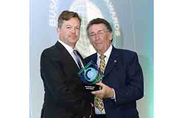 Jonathan Harding, Qatar Airways' Senior Vice President, North, South and Western Europe, receiving the award for Best Business Class Airline from actor Robert Powell at the recent Business Traveller awards in London.