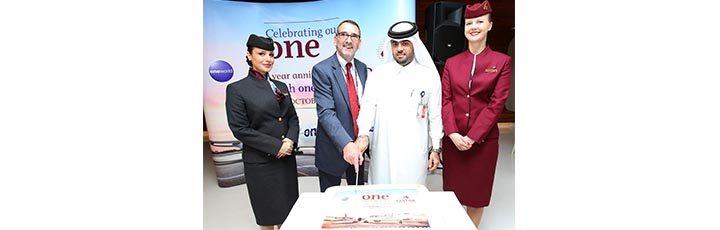 Hamad International Airport Chief Operating Officer, Mr. Badr Al Meer (second from right) and Qatar Airways Chief Planning Officer, Mr. Richard Roberts (third from right), cut a celebratory cake in commemoration of the first year anniversary of Qatar Airways joining the oneworld global airline alliance.