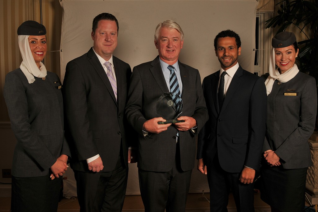 """Etihad Airways executives and cabin crew receive award for 2014 Airline of the Year at Global Traveler's """"11th Annual GT Tested Reader Survey Awards"""", including (from left to right) Michael Kohlstrand, Vice President Western USA, Geert Boven, Senior Vice President of the Americas and Mohammed Hasan Rahma, Business Development Manager."""