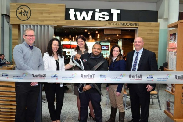 Cutting the ribbon, from left to right: Mike Ross, Director of Commercial Development & Passenger Communications, Greater Toronto Airport Authority; Giovanna Verrilli, Associate Director of Retail and Food Programs, Greater Toronto Airport Authority; Suzanne Merrell, Senior Manager of Food & Beverage Programs, Greater Toronto Airport Authority; Roger Mooking, Chef, Twist; Amy Dunne, Vice President of Business Development, HMSHost; Neil Thompson, Vice President, Canada, HMSHost