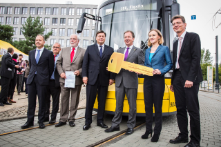 Bombardier Transportation President and Chief Operating Officer Dr. Lutz Bertling presents the 100th FLEXITY to BVG