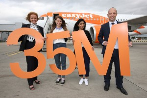 easyJet's Ali Gayward and Liverpool Airport's Colin Swaine Celebrate easyJets 35th Million Passenger with the lucky recipients of the free flights