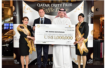 Hamad International Airport's Vice President Commercial - HIA, Mr Abdulaziz Al Mass (second from right) and Qatar Duty Free's Vice President of Branded Stores, Mr Luis Gasset (second from left) hold a cheque in the amount of one million USD for Qatar Duty Free's 20th winner of the Millionaire Draw.