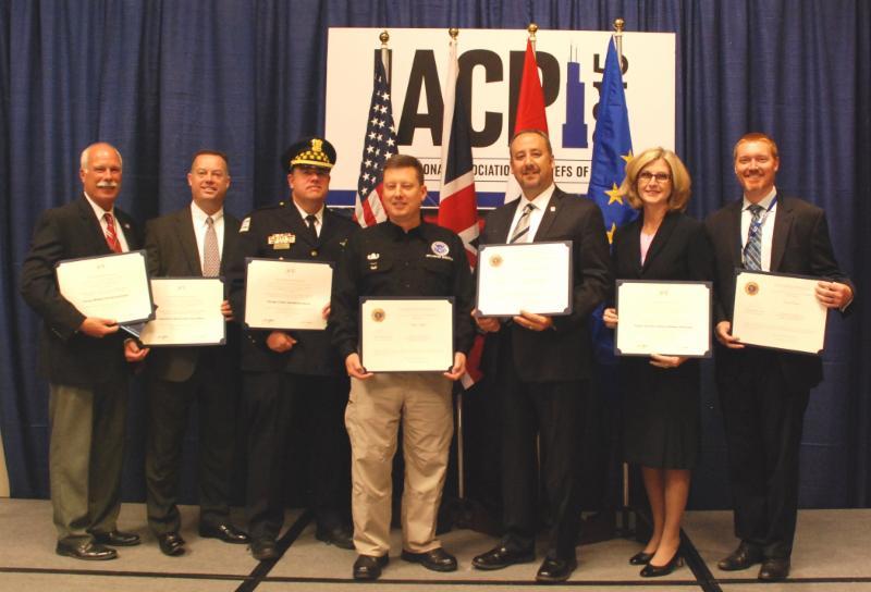 (L-r) 9/11 Medal Awardees Richard Edgeworth, CDA; David Mertz, FBI; Thomas O'Brien, CPD; Phillip Haffron, TSA; Benjamin Fernandex, TSA; Kathleen Petrowsky, TSA and Ross Preston, TSA.