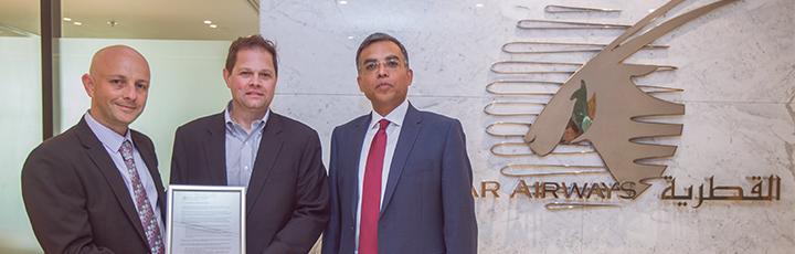 Qatar Airways SVP Group Safety & Security, Mr. Ashish Jain (right) and Qatar Airways VP Environmental Affairs, Mr. Iain. Groark (left) sign environmental pledge with SAFUG representative Mr. Darrin Morgan, Sustainable Aviation Fuel Manager, Boeing.