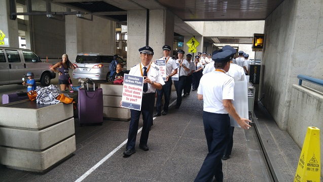 An estimated 300 Hawaiian Airlines pilots conducted informational picketing at Honolulu International Airport.