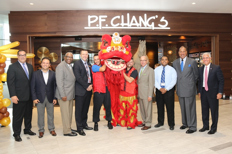 "From left to right: Michael Price, Vice President of Business Development, HMSHost; Genaro Perez, Vice President of Global Marketing, P.F. Chang's China Bistro, Inc.; Derryl Benton, Executive Vice President of Business Development, HMSHost; Zydrunas Rackauskas, Director of Operations, Tinsley Family Concessions; Joe Lopano, CEO, Tampa International Airport; Anthony ""AJ"" Summers, Director of Operations, Tinsley Family Concessions; George Tinsley Sr., CEO, Tinsley Family Concessions; John Tiliacos, Vice President of Operations, Tampa International Airport."
