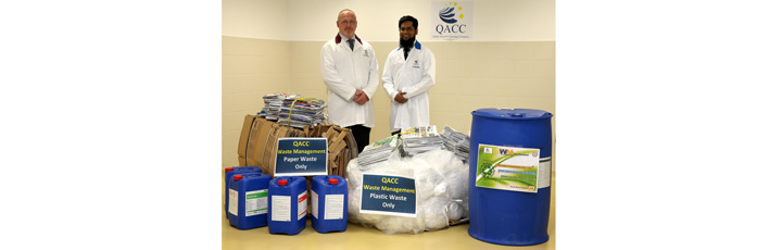 Mr. Paul Thomson Acting Senior Vice President for Qatar Aviation Catering Company (left) and Mr. Mohammed Shoaib, Uniform and Linen Duty Officer QACC (right), with some of the materials due to be recycled under the new programme.